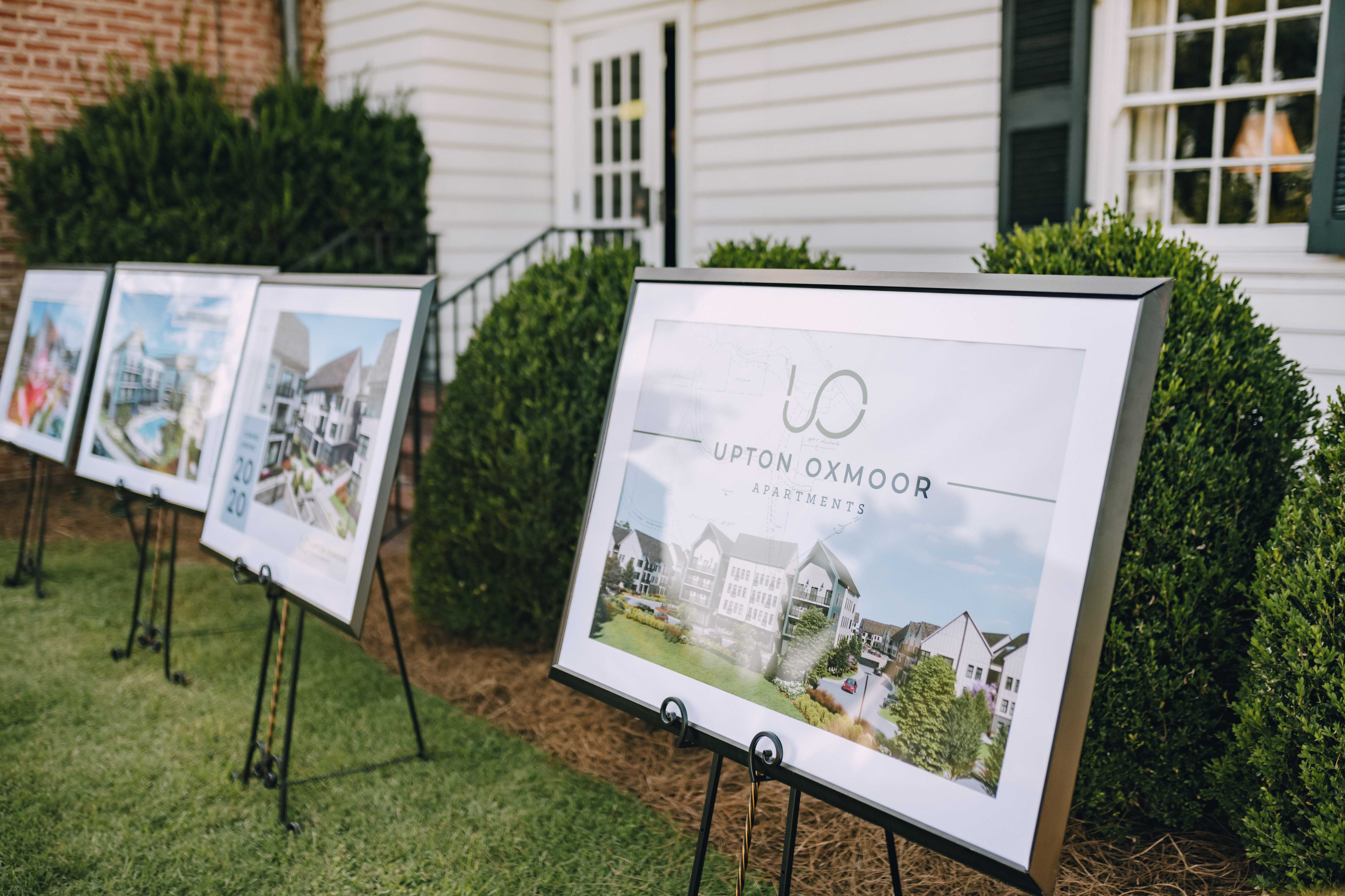 Upton Oxmoor Renderings displayed on tripods
